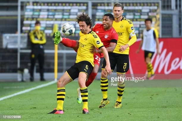 Serge Gnabry of Bayern Munich battles for possession with Thomas Delaney of Borussia Dortmund during the Bundesliga match between Borussia Dortmund...