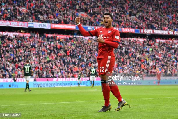 Serge Gnabry of Bayern Munich celebrates after his team's second goal during the Bundesliga match between FC Bayern Muenchen and VfL Wolfsburg at...