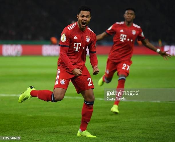 Serge Gnabry of Bayern Munich celebrates after scoring his sides first goal during the DFB Cup match between Hertha BSC and FC Bayern Muenchen at...