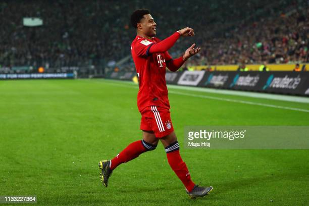 Serge Gnabry of Bayern Munich celebrates after scoring his team's fourth goal during the Bundesliga match between Borussia Moenchengladbach and FC...
