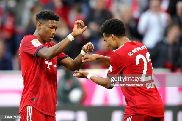Serge Gnabry of Bayern Munich celebrates after scoring his team's fourth goal with David Alaba of Bayern Munich during the Bundesliga match between...