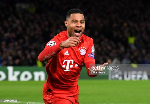 Serge Gnabry of Bayern Munich celebrates after scoring his team's first goal during the UEFA Champions League round of 16 first leg match between...