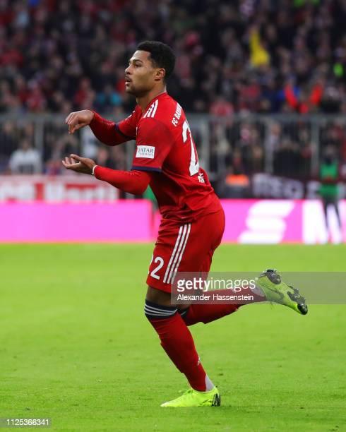 Serge Gnabry of Bayern Munich celebrates as Christian Gentner of VfB Stuttgart scores an own goal for their second goal during the Bundesliga match...