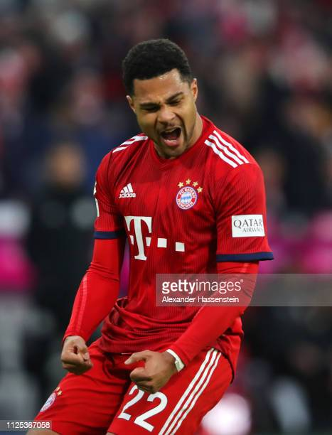 Serge Gnabry of Bayern Munich celebrates as Christian Gentner of VfB Stuttgart scores an own goal for their second goal during the Bundesliga match...