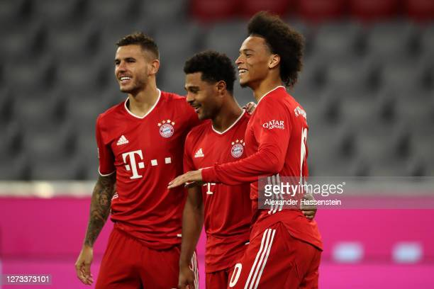 Serge Gnabry of Bayern Munich celebrates scoring his teams fourth goal of the game with team mates Lucas Hernandez and Leroy Sane during the...