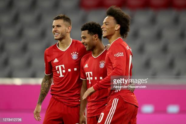 Serge Gnabry of Bayern Munich celebrates scoring the 4th team goal with his team mates Leroy Sane and Lucas Hernandez during the Bundesliga match...