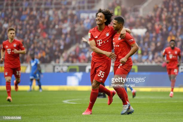 Serge Gnabry of Bayern Munich celebrates with teammate Joshua Zirkzee during the Bundesliga match between TSG 1899 Hoffenheim and FC Bayern Muenchen...