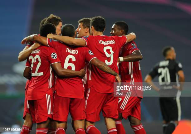 Serge Gnabry of Bayern Munich celebrates with teammates after scoring his team's second goal during the UEFA Champions League Semi Final match...