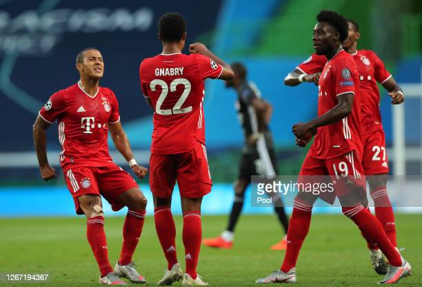 Serge Gnabry of Bayern Munich celebrates with teammates Thiago Alcantara and Alphonso Davies after scoring his team's first goal during the UEFA...