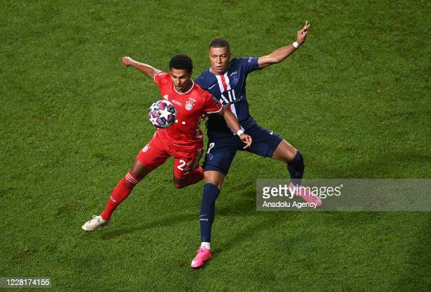 Serge Gnabry of Bayern Munich in action against Kylian Mbappe of PSG during the UEFA Champions League final football match between Paris...