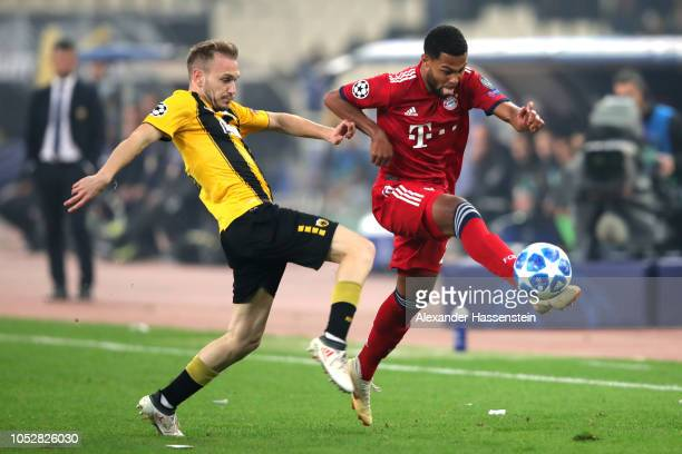Serge Gnabry of Bayern Munich is challenged by Michalis Bakakis of AEK Athens during the Group E match of the UEFA Champions League between AEK...