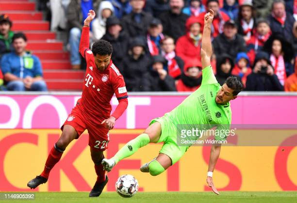 Serge Gnabry of Bayern Munich is challenged by Miiko Albornoz of Hannover 96 during the Bundesliga match between FC Bayern Muenchen and Hannover 96...