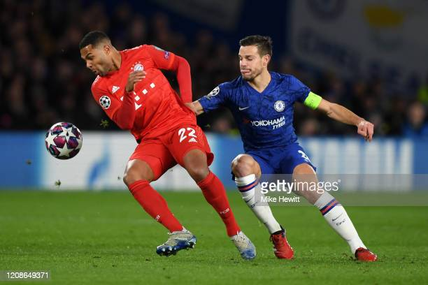 Serge Gnabry of Bayern Munich is closed down by Cesar Azpilicueta of Chelsea during the UEFA Champions League round of 16 first leg match between...