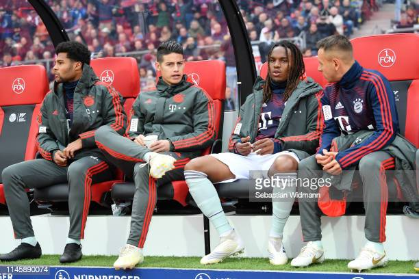 Serge Gnarby of Bayern Munich James Rodriguez Renato Sanches and Rafinha of Bayern Munich sit on the bench during the Bundesliga match between 1 FC...