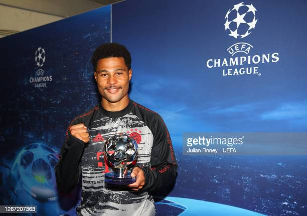 Serge Gnabry of Bayern Munich pose for a photo with the UEFA Champions League Man of the Match award following his sides victory in the UEFA...