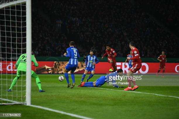 Serge Gnabry of Bayern Munich scores his sides first goal during the DFB Cup match between Hertha BSC and FC Bayern Muenchen at Olympiastadion on...