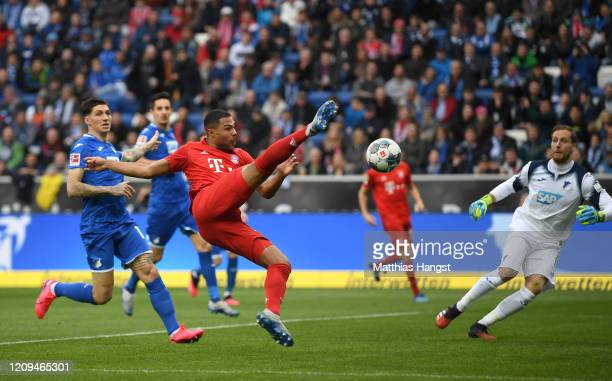 Serge Gnabry of Bayern Munich scores his teams first goal during the Bundesliga match between TSG 1899 Hoffenheim and FC Bayern Muenchen at...