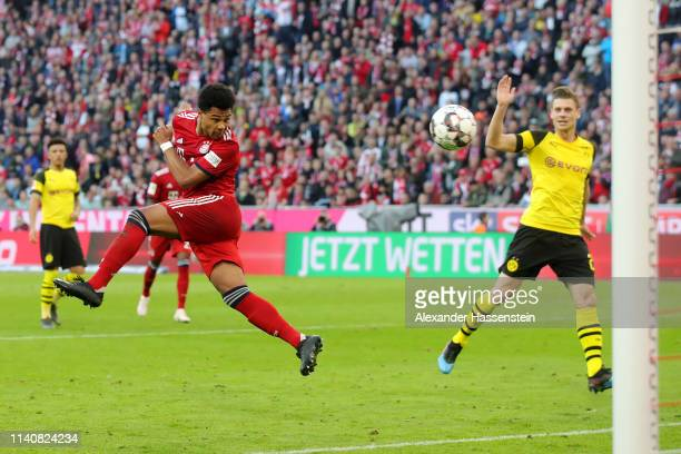 Serge Gnabry of Bayern Munich scores his team's fourth goal during the Bundesliga match between FC Bayern Muenchen and Borussia Dortmund at Allianz...