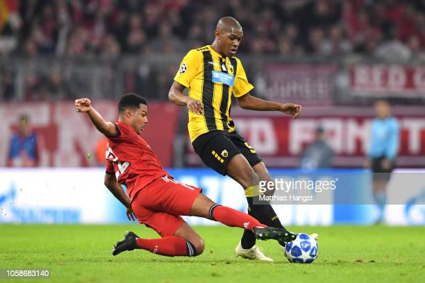 Serge Gnabry of Bayern Munich tackles Alef of AEK Athens during the UEFA Champions League Group E match of the between FC Bayern Muenchen and AEK...