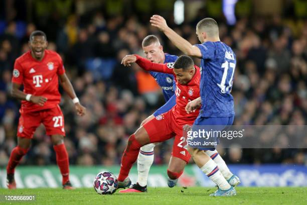 Serge Gnabry of Bayern Munich with Ross Barkley and Mateo Kovacic of Chelsea during the UEFA Champions League round of 16 first leg match between...