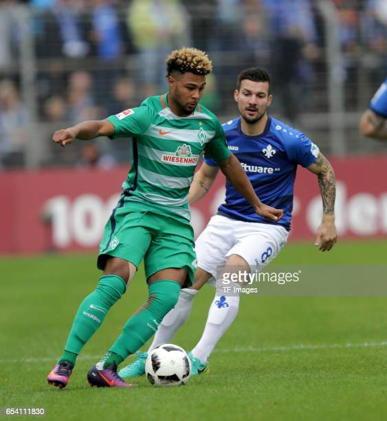 Serge Gnabry of Bremen and Jerome Gondorf of Darmstadt battle for the ball during the Bundesliga match between SV Darmstadt 98 and Werder Bremen at...