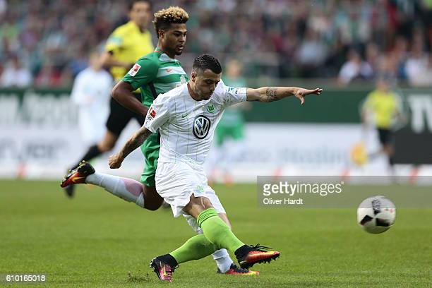 Serge Gnabry of Bremen and Vierinha of Wolfsburg compete for the ball during the Bundesliga match between Werder Bremen and VfL Wolfsburg at...