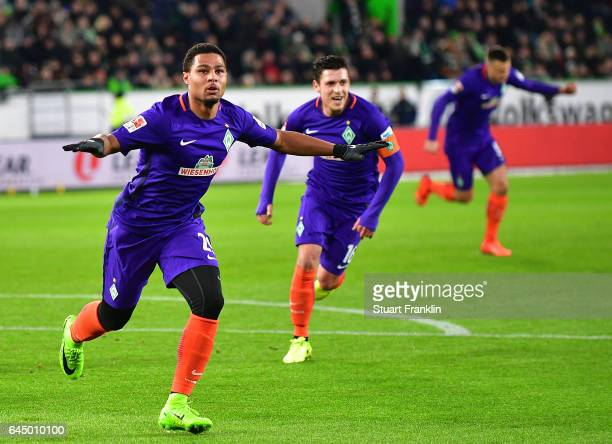 Serge Gnabry of Bremen celebrates scoring the first goal during the Bundesliga match between VfL Wolfsburg and Werder Bremen at Volkswagen Arena on...