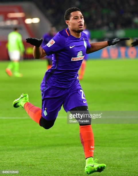 Serge Gnabry of Bremen celebrates scoring the first goal during the Bundesliga match between VfL Wolfsburg and Werder Bremen at Volkswagen Arena on...