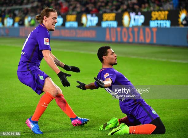 Serge Gnabry of Bremen celebrates scoring the first goal with Max Kruse during the Bundesliga match between VfL Wolfsburg and Werder Bremen at...
