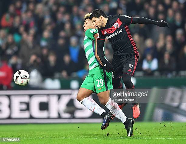 Serge Gnabry of Bremen is challenged by Almog Cohen of Ingolstadt during the Bundesliga match between Werder Bremen and FC Ingolstadt 04 at...