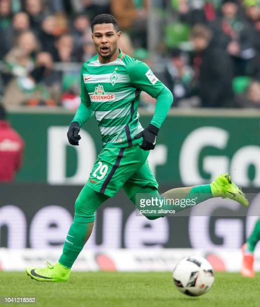 Serge Gnabry of Bremen plays the ball during the German Bundesliga soccer match between SV Werder Bremen and Borussia Moenchengladbach at the...