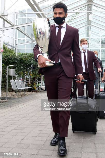 Serge Gnabry of FC Bayern Muenchen arrives with the Uefa Supercup Winners Trophy at Franz-Josef-Strauss International Airport Munich on September 25,...