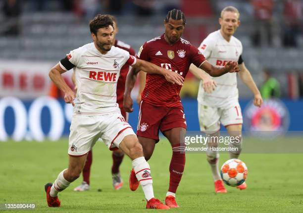 Serge Gnabry of FC Bayern Muenchen battles for possession with Jonas Hector of 1.FC Koeln during the Bundesliga match between FC Bayern München and...