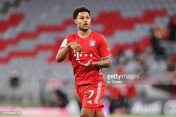 Serge Gnabry of FC Bayern Muenchen celebrates scoring his teams first goal during the Bundesliga match between FC Bayern Muenchen and FC Schalke 04...