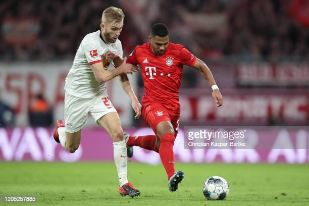 Serge Gnabry of FC Bayern Muenchen challenges Konrad Laimer of RB Leipzig during the Bundesliga match between FC Bayern Muenchen and RB Leipzig at...