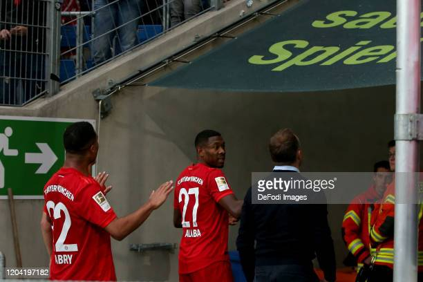 Serge Gnabry of FC Bayern Muenchen, David Alaba of FC Bayern Muenchen and head coach Hansi Flick of FC Bayern Muenchen gestures after the Bundesliga...