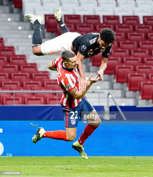 Serge Gnabry of FC Bayern Muenchen is fouled by Mario Hermoso of Atletico Madrid during the UEFA Champions League Group A stage match between...