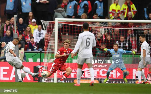 Serge Gnabry of FC Bayern Muenchen scores his sides fourth goal during the Bundesliga match between 1 FC Koeln and FC Bayern Muenchen at...