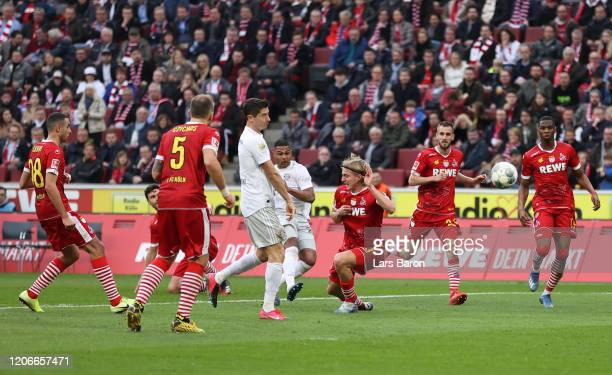 Serge Gnabry of FC Bayern Muenchen scores his sides fourth goal during the Bundesliga match between 1. FC Koeln and FC Bayern Muenchen at...