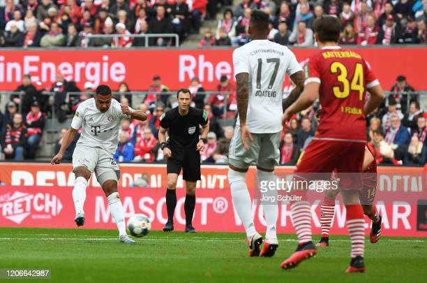 Serge Gnabry of FC Bayern Muenchen scores his sides third goal during the Bundesliga match between 1. FC Koeln and FC Bayern Muenchen at...