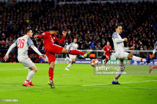 Serge Gnabry of FC Bayern Muenchen shoots across goal leading to his sides first goal during the UEFA Champions League Round of 16 Second Leg match...