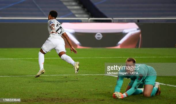 Serge Gnabry of FC Bayern Munich celebrates after scoring his team's third goal as MarcAndre ter Stegen of FC Barcelona looks dejected during the...