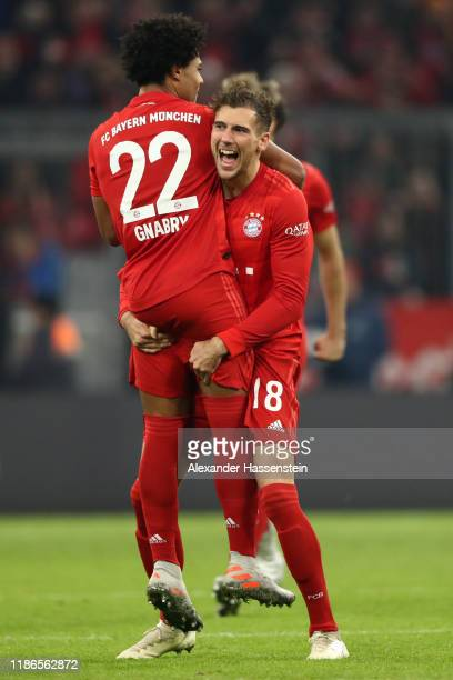 Serge Gnabry of FC Bayern Munich celebrates with teammate Leon Goretzka after scoring his team's second goal during the Bundesliga match between FC...
