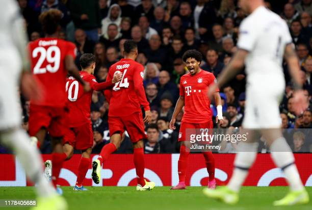Serge Gnabry of FC Bayern Munich celebrates with teammates after scoring his team's fourth goal during the UEFA Champions League group B match...
