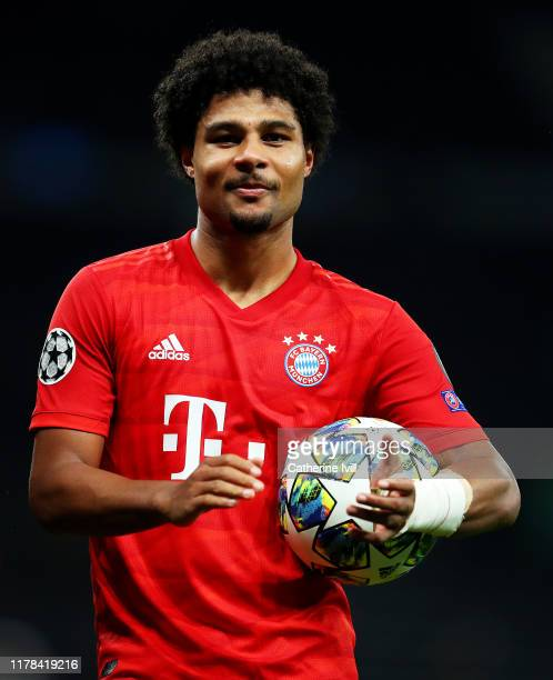 Serge Gnabry of FC Bayern Munich celebrates with the match ball at fulltime after scoring four goals in the UEFA Champions League group B match...