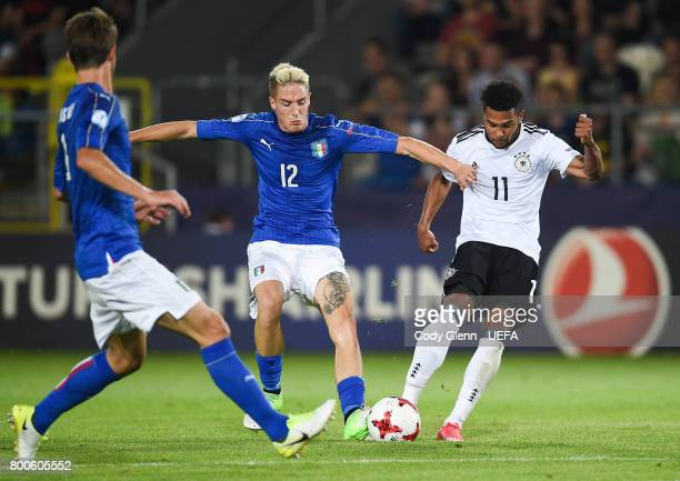Serge Gnabry of Germany and Andrea Conti of Italy during their UEFA European Under21 Championship 2017 match on June 24 2017 in Krakow Poland