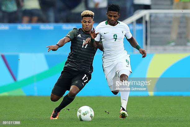 Serge Gnabry of Germany and Imoh Ezekiel of Nigeria compete for the ball during the Men's Semifinal Football match between Nigeria and Germany on Day...
