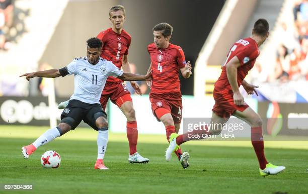 Serge Gnabry of Germany and Michal Svek of Czech Republic during their UEFA European Under21 Championship match on June 18 2017 in Tychy Poland