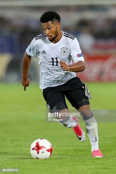 Serge Gnabry of Germany battle for the ball during the UEFA U21 championship match between Italy and Germany at Krakow Stadium on June 24 2017 in...