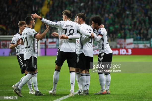 Serge Gnabry of Germany celebrates after scoring his team`s first goal with team mates during the UEFA Euro 2020 Qualifier between Germany and...